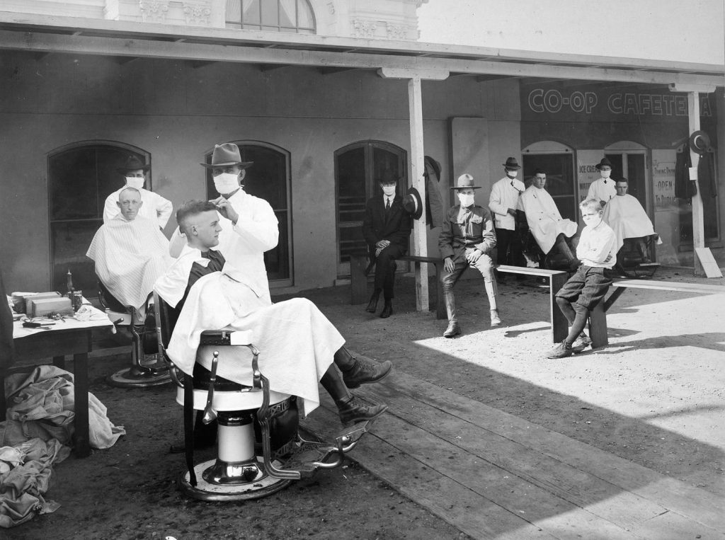 social distancing at outdoor barber shop during 1918 Spanish Flu